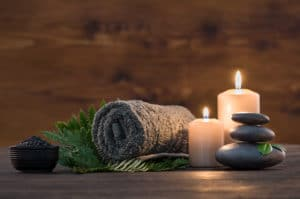 romantic spa materials, hot towel, candles, hot rocks