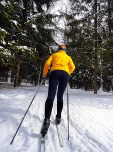 cross-country skiing and snowshoeing in the forest