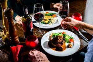 Couple Having Romantic Dinner In A Laconia Restaurant