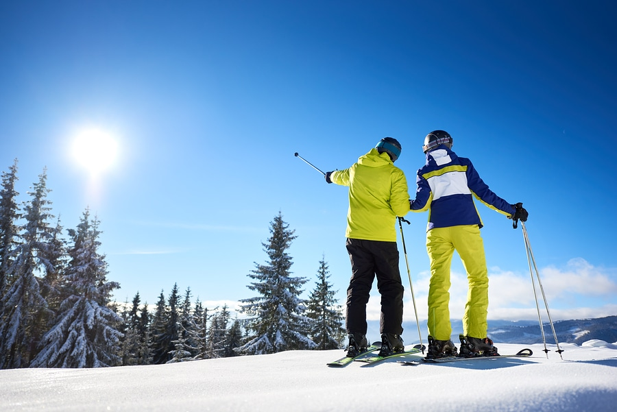 Couple on skies on snowy Gunstock Mountain