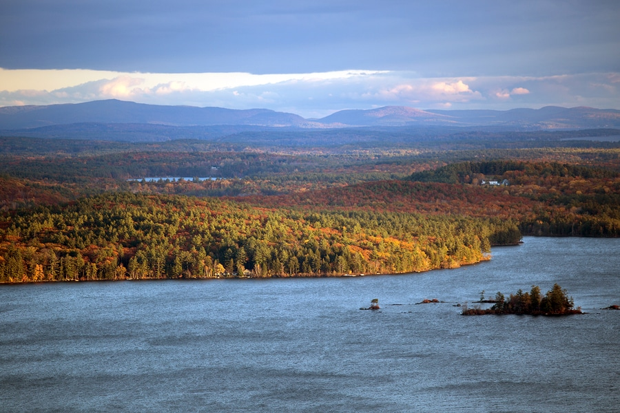 Mountains And Squam Lake In New Hampshire At Fall Time in the Lakes Region NH